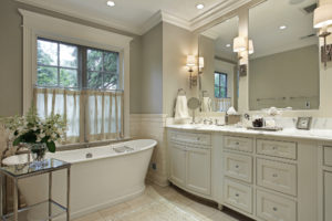 Master bath in luxury home with marble counter