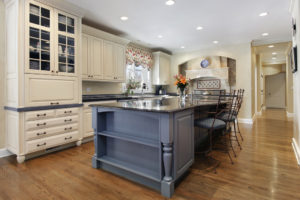 Upscale kitchen with a gray cabinet granite island. adding an island to your kitchen, southern maryland